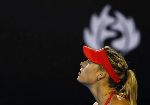 Sharapova of Russia looks up at the sky as rain falls during her women's singles final match against Williams of the U.S. at the Australian Open 2015 tennis tournament in Melbourne