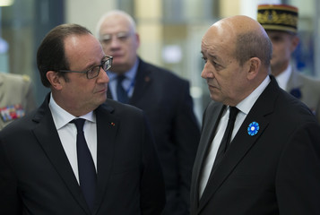 French president Francois Hollande and French defence minister Jean-Yves Le Drian attend the inauguration ceremony of the new headquarters for the French Ministry of Defence in the Balard district in Southern Paris