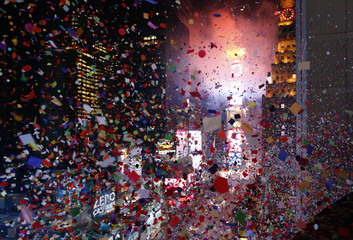 Confetti is dropped on revellers at midnight during New Year celebrations in Times Square in New York