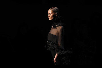 A model presents a creation by Singapore-born designer Andrew GN as part of his Fall/Winter 2016/2017 women's ready-to-wear collection show in Paris