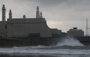 A wave hits Tokyo Electric Power Co.'s Kashiwazaki Kariwa nuclear power plant, which is the world's biggest, in Kashiwazaki