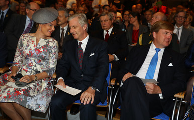 Belgium's Queen Mathilde speaks to King Philippe next to King Willem Alexander of the Netherlands during the opening of the book fair in Frankfurt