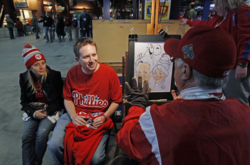 Philadelphia Phillies fans pose for a drawing before the start of play between the Phillies and the San Francisco Giants in their Major League League Baseball NLCS playoff series in Philadelphia