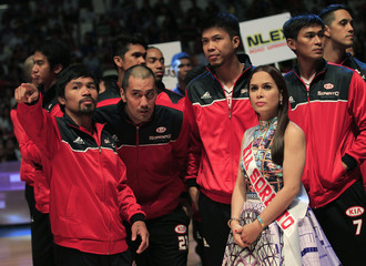 Pacquiao, the playing coach of KIA-Sorento, gesture as he joins his teammates during the opening of the 40th Season of the Philippine Basketball Association (PBA) games in  Bocaue town