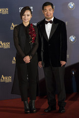 Bibi and actor Zhang pose on the red carpet at the Asian Film Awards in Macau