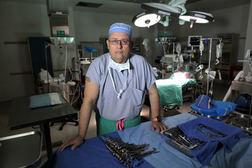 Ivan Gonzalez, who is the first cardiac surgeon to perform heart transplants in Puerto Rico, poses for a photograph in San Juan