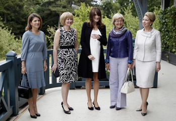 France's First Lady Bruni-Sarkozy, wife of EC PR Margarida Barroso, Canada's PM wife Laureen Harper, wife of European Council PR Geertri Van Rompuy and Russia's PR wife Svetlana Medvedeva pose after their arrival at the G8 summit in Deauville