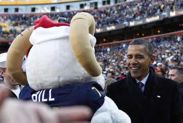 U.S. President Barack Obama greets the Navy mascot Billy the Goat on the sidelines during pre game at the Army Navy football game in Landover, Maryland