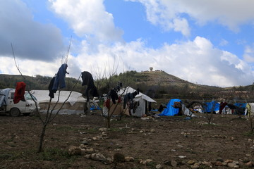 A general view shows tents housing internally displaced people in the town of Khirbet Al-Joz, in Latakia countryside, near the Syrian-Turkish border