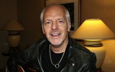 Musician Peter Frampton poses for a picture inside his hotel room in New York