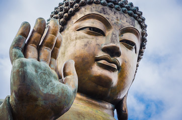 Close up of Tian Tan Buddha with details of hand - The worlds's tallest outdoor seated bronze Buddha located in Lantau Island, Hong Kong, China
