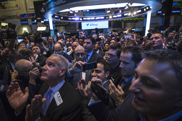 Twitter CEO Costolo takes photo as Twitter begins to trade during the IPO on the floor of the New York Stock Exchange in New York