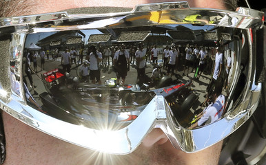 The car of McLaren driver Hamilton is reflected in the glasses of a mechanic during preparations for Sunday's Brazilian Grand Prix F1 race, in Sao Paulo