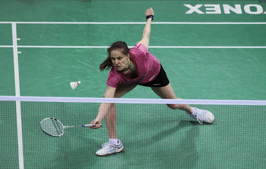 Schenk of Germany returns a shot to Wang of China during the Yonex Sunrise India Open badminton tournament in New Delhi