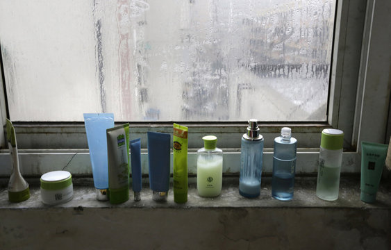 Skincare products stand on a window sill in a dormitory at Huaxia Liangtse Massage Training Centre in Zhengzhou, Henan province