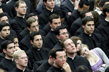 Members of the faithful attend Pope Benedict XVI's weekly audience in the Paul VI hall at the Vatican