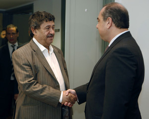 Libya's Foreign Minister Obeidi shakes hands with Cyprus' Foreign Minister Kyprianou in Nicosia