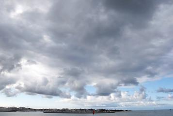 Dark clouds fill the sky over the Atlantic ocean coast  in La Rochelle, southwestern France