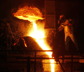 An employee works in a ferronickel smelter owned by state miner Aneka Tambang Tbk at Pomala district in Indonesia