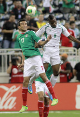 Jesus Zavala of Mexico and Aide Brown Ideye of Nigeria head the ball during the first half of their international friendly soccer match in Houston
