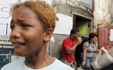 Santos de Souza cries after her eviction outside the former Brazilian Palace Hotel in downtown Sao Paulo