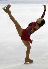 Asada of Japan performs during the Ladies Short Program event at the World Figure Skating Championships in Turin