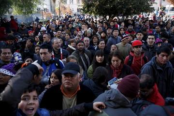Fans gather outside a court at San Bernardo town, nearby Santiago city