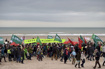 People take part in a march against climate change in Ostend