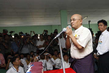 Comedian, actor and newly released political prisoner Zagana speak at a ceremony to mark political activist Min Ko Naing's 49th birthday in Yangon