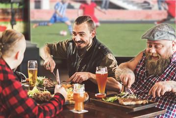 Joyful bearded men having fun together