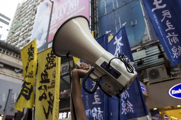 A localist protester holds up a bullhorn during an anti-China protest at Mongkok shopping district in Hong Kong, China