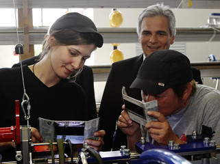 Austrian Chancellor Faymann watches workers during a visit to Schoeller Bleckmann stainless steel pipes factory in Ternitz