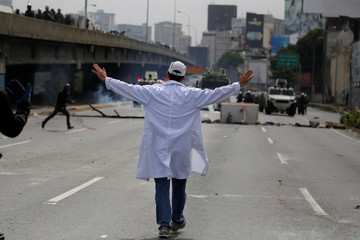 A doctor reacts during a rally called by health care workers and opposition activists against Venezuela's President Nicolas Maduro in Caracas