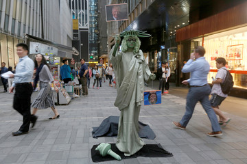 A street performer dressed as the Statue of Liberty in Hong Kong