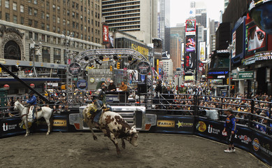 Professional bull rider Mike Lee takes part in a bull riding competition held in New York's Times Square