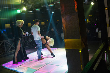 A man participates in a drag performance at Mayak, a gay cabaret club in Sochi