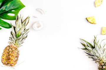 summer dessert with pineapples and leaves on white background top view mock up
