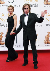 William H. Macy and Felicity Huffman arrive for the closing ceremony of the 51st Monte Carlo television festival in Monaco