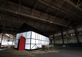 "An installation titled ""Deutsche Scheune/German Barn, 2011"" is seen inside an old hanger of the Old Kallang Airport during the Singapore Biennale 2011 in Singapore"