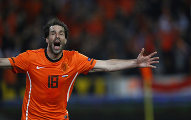 Netherlands' Ruud van Nistelrooy celebrates scoring against Hungary during their Euro 2012 qualifying Group E soccer match at the Amsterdam Arena