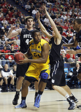 Marquette University's Gardner fights pressure from Butler University's Smith and Dunham during their third round NCAA basketball game in Lexington