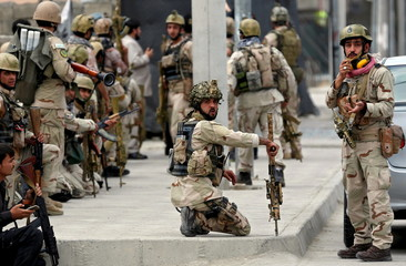 Members of Afghan security forces arrive at the site of an attack near the Afghan parliament in Kabul