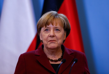 German Chancellor Angela Merkel attends a press conference in Warsaw