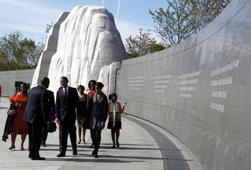 U.S. President Barack Obama walks with his family and members of the King family at the dedication ceremony of the Martin Luther King, Jr. Memorial in Washington