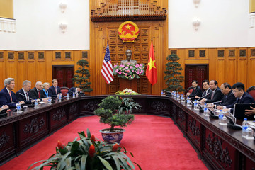 US Secretary of State John Kerry talks to Vietnam's Prime Minister Nguyen Xuan Phuc during a meeting at the Government Office in Hanoi, Vietnam