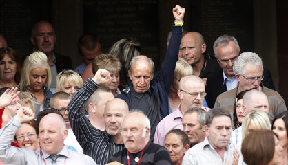 Relatives of Bloody Sunday shooting victims react as they leave the Guildhall after reading the Saville report in Londonderry
