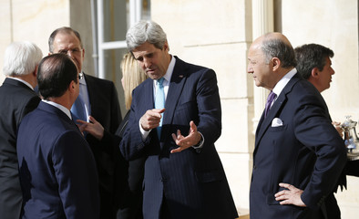U.S. Secretary of State Kerry and Russia's Foreign Minister Lavrov attend the Lebanon conference in Paris