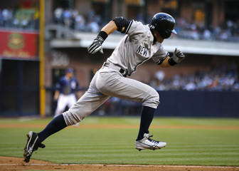 New York Yankees right fielder Ichiro Suzuki runs out of the batters box in San Diego