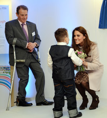Britain's Catherine, Duchess of Cambridge is presented with a bouquet of flowers by Jamie Andrew, age seven, during a visit to the City Hospital in Peterborough