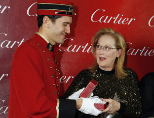 """Actress Streep, star of film """"August: Osage County"""" poses backstage with her Icon Award as she receives a gift from Cartier at the Palm Springs International Film Festival Awards Gala"""